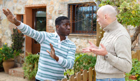 Quarrel of two neighbors in the country in the village