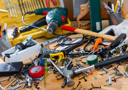 Hand tools in mess on wooden table