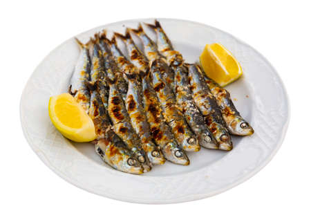 Close up of Andalusian fried sardines on white plate