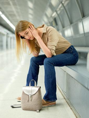 Young woman waiting for train at subway station