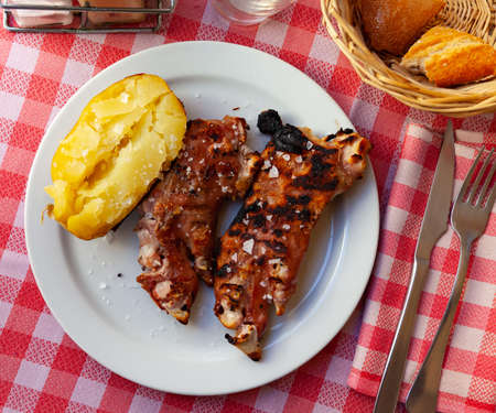 Spicy pig trotters grill with baked potato