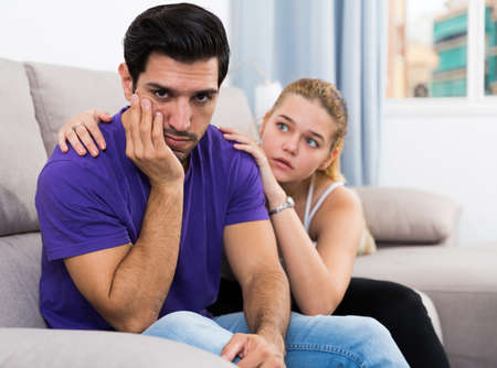 Woman calming distressed husband