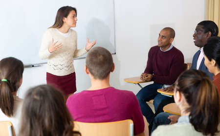 Female high school teacher standing in front of interactive whiteboard teaching lesson Stock fotó