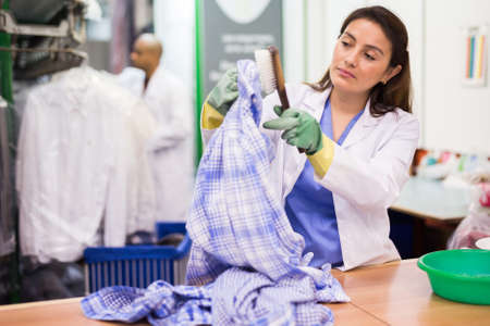 Portrait of female laundry worker during daily work