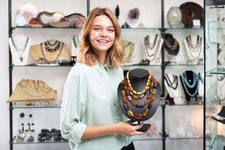Saleswoman demonstrating amber beads