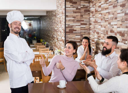 Professional chef listens to praise of the food