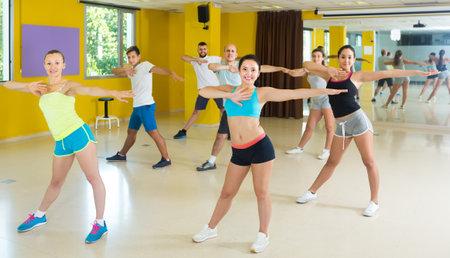 Happy men and women performing modern dance