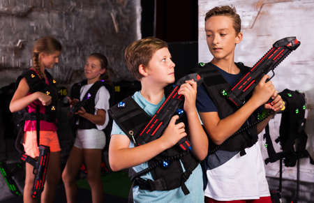 Two boys ready for lasertag game Stock Photo