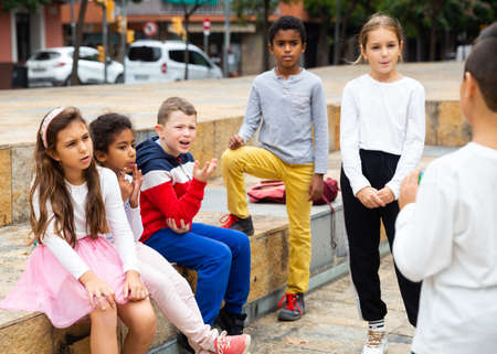 Cheerful tweens spending time together on city street