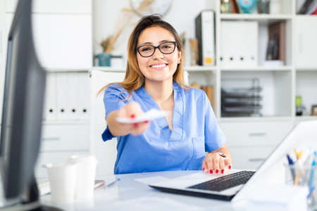 Latino female doctor working with patient