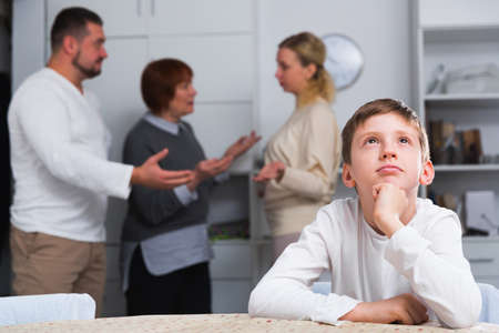 Upset son suffering from parental arguing