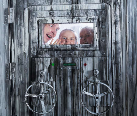 Mad family is trying to get out of a locked door Standard-Bild