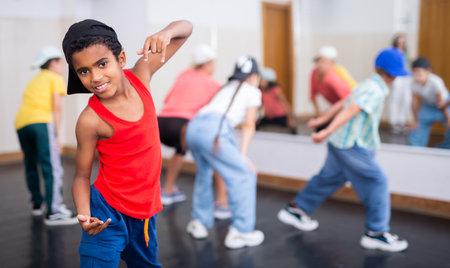 Afro boy hip hop dancer exercising at class