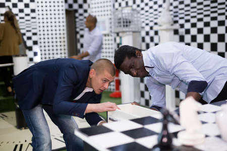 Four friends looking for way out of chess quest room