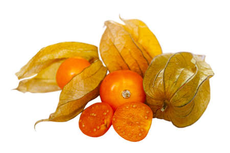 Whole and cut in half fruits of physalis