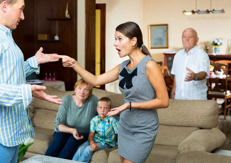 Outraged woman talking to man