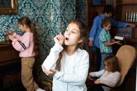 Pensive girl pointing with her forefinger in quest room Stock Photo
