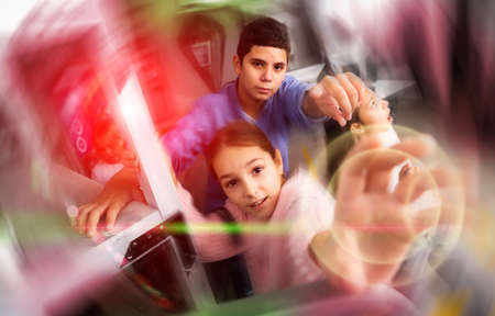 Interested tweens trying to get out of escape room, toned image Stock Photo