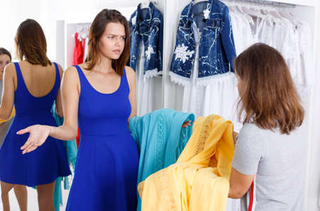 Girl expressing her indignation about quality of clothes