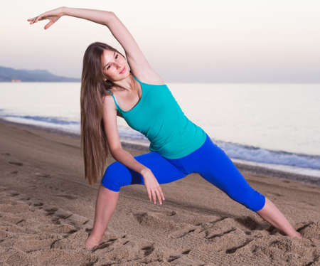Portrait of sportswoman which is doing excercises on endurance