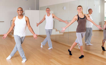 Man dancing at group lesson in studio