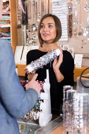 Positive seller showing bracelets for consumer