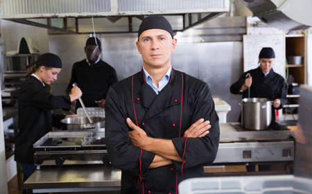Confident chef in restaurant kitchen