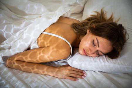 Ggirl in underwear sleeping in bed