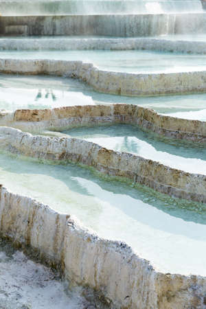 Natural travertine terraces with hot springs in Pamukkale, Turkey