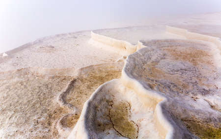 White travertine formations at hot springs of Pamukkale, Turkey Stock Photo