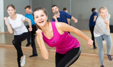 Woman training at group dance class