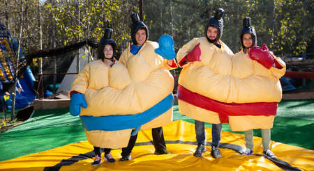 Men and women dressed as sumo wrestlers