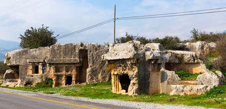 Remains of stone cut tombs in ancient Araxa, Turkey
