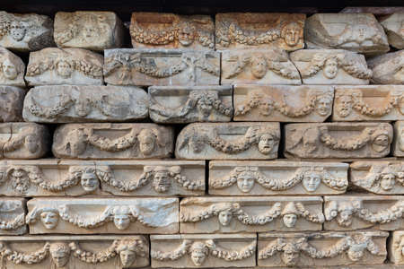 bas-reliefs in the form of masks in Aphrodisias, Turkey