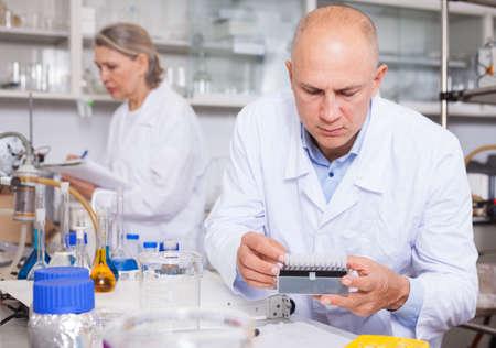 Chemist analyzing liquid samples