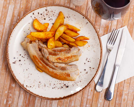 Delicious roasted pork belly with french fries