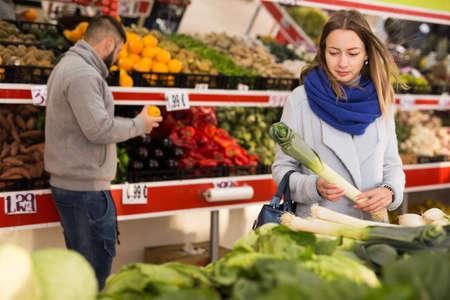 Portrait of woman shopping fresh leek in shop