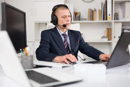 Portrait of friendly man call center operator