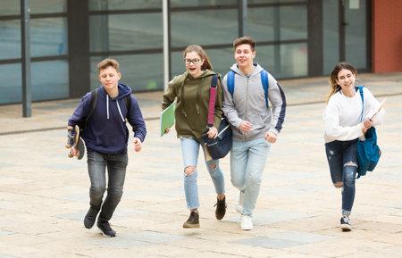 Teenager school kids running