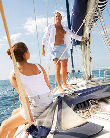 Man on sailboat with woman