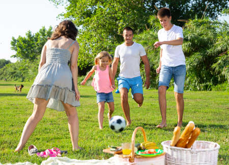Cheerful family playing with ball