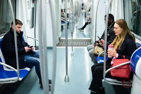 People riding subway