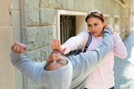 Woman defends herself from attacker rapist on street