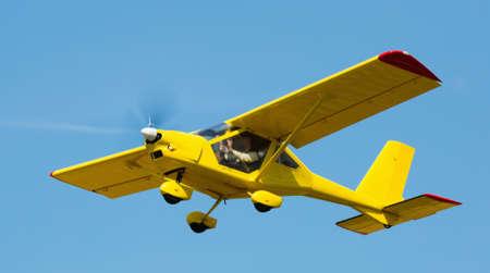 Sport airplane soaring in sky