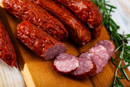 Roasted chezh sausages susena on cutting board Reklamní fotografie