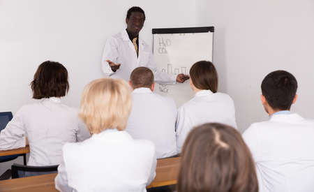 African American male lecturing at medical conference