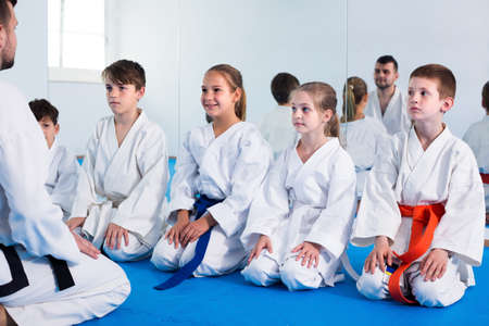 Smiling kids sparring in pairs