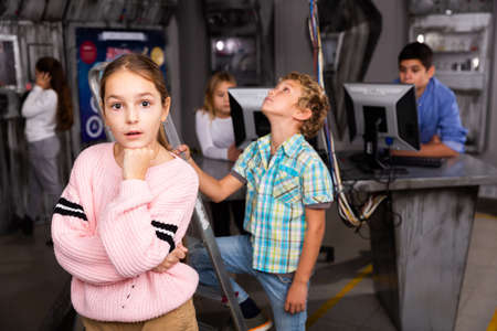 Thoughtful tween girl thinking in escape room bunker Stock Photo