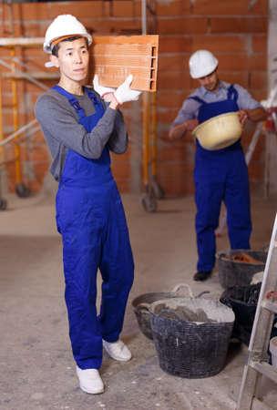 Builders doing finishing work