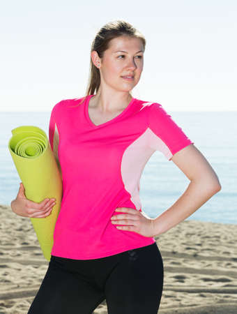Girl ready for workout on seashore